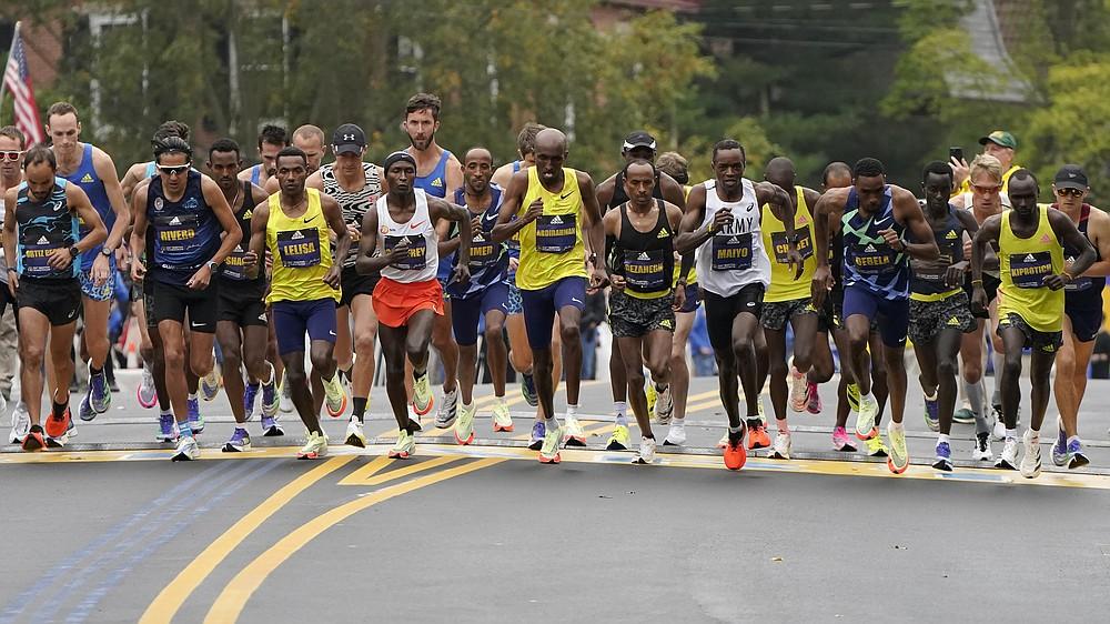 The elite men break from the starting line of the 125th Boston Marathon, Monday, Oct. 11, 2021, in Hopkinton, Mass. (AP Photo/Steven Senne)