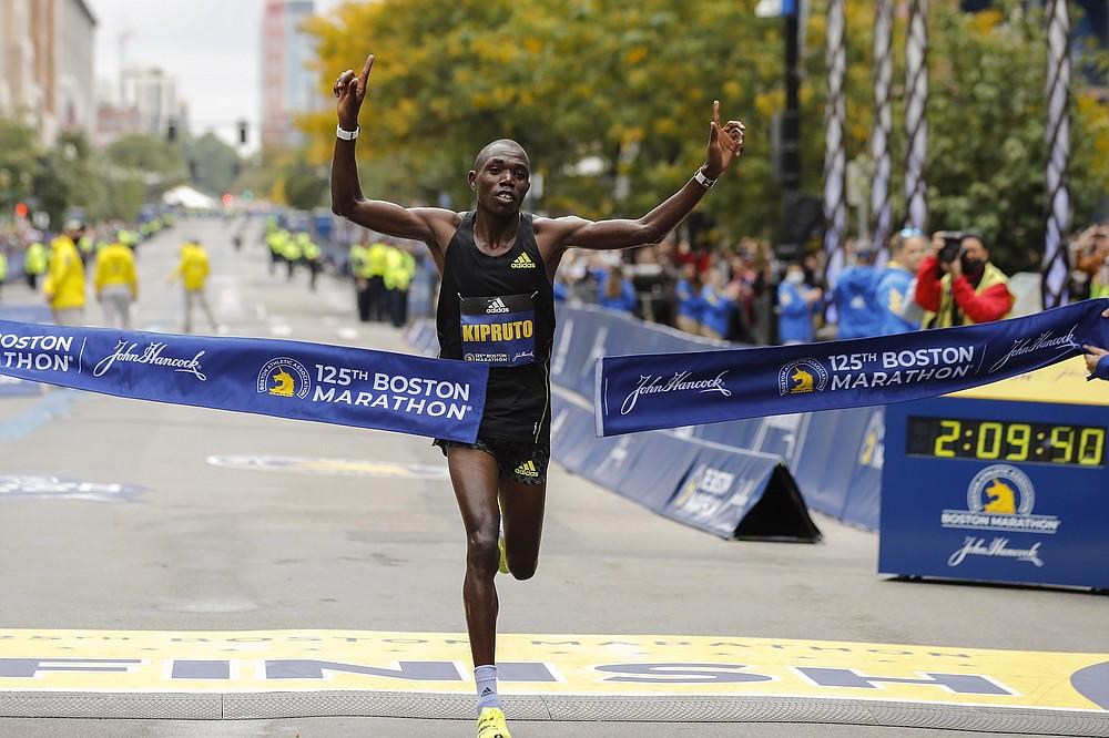 Benson Kipruto, of Kenya, approaches the tape to win the 125th Boston Marathon on Monday, Oct. 11, 2021, in Boston. (AP Photo/Winslow Townson)