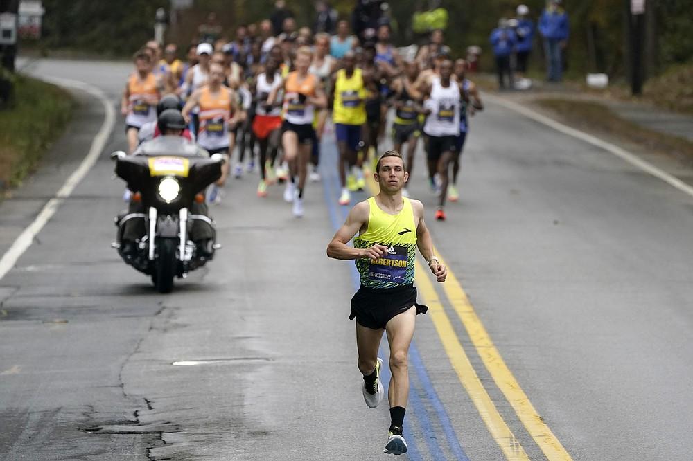CJ Albertson, of Fresno, Calif., front, leads a group of elite men in the 125th Boston Marathon, Monday, Oct. 11, 2021, in Hopkinton, Mass. (AP Photo/Steven Senne)