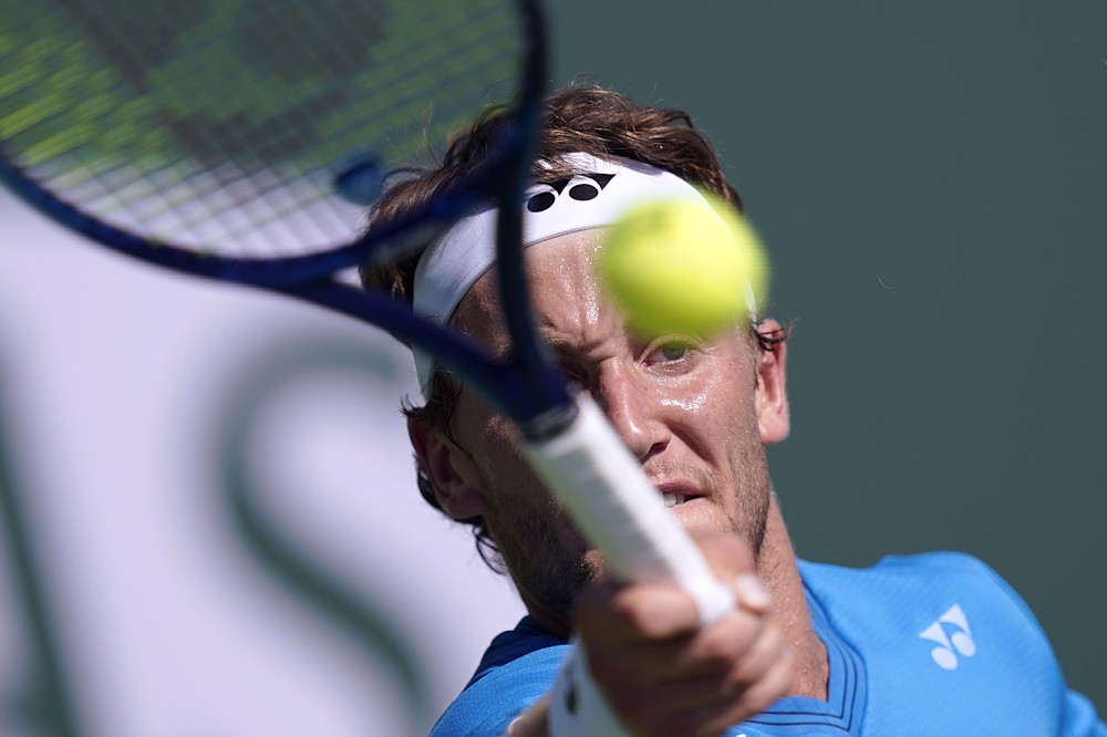Casper Ruud, of Norway, returns to Lloyd Harris, of South Africa, at the BNP Paribas Open tennis tournament Monday, Oct. 11, 2021, in Indian Wells, Calif. (AP Photo/Mark J. Terrill)