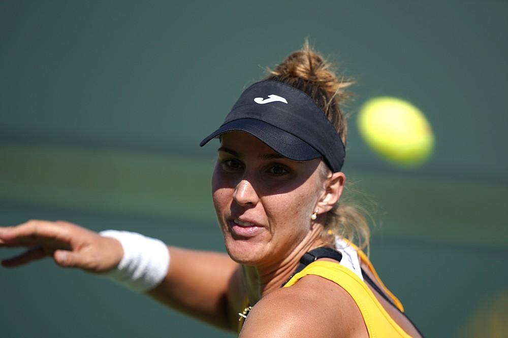 Beatriz Haddad Maia, of Brazil, returns to Karolina Pliskova, of the Czech Republic, at the BNP Paribas Open tennis tournament Monday, Oct. 11, 2021, in Indian Wells, Calif. (AP Photo/Mark J. Terrill)
