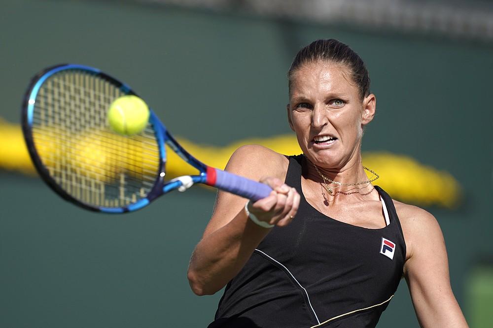 Karolina Pliskova, of the Czech Republic, returns to Beatriz Haddad Maia, of Brazil, at the BNP Paribas Open tennis tournament Monday, Oct. 11, 2021, in Indian Wells, Calif. (AP Photo/Mark J. Terrill)