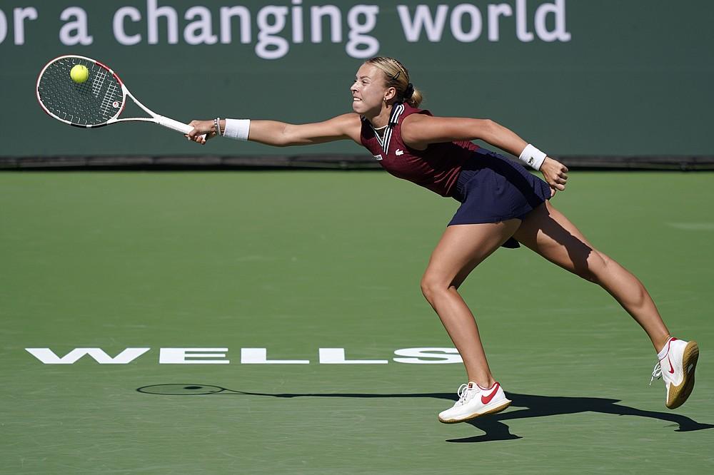 Anett Kontaveit, of Estonia, returns to Bianca Andreescu, of Canada, at the BNP Paribas Open tennis tournament Monday, Oct. 11, 2021, in Indian Wells, Calif. (AP Photo/Mark J. Terrill)