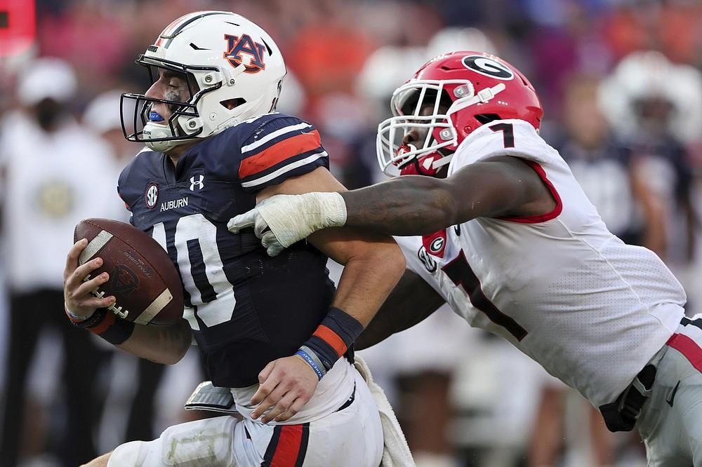 Auburn quarterback Bo Nix (10) is sacked by Georgia linebacker Quay Walker (7) during the second half of an NCAA college football game Saturday, Oct. 9, 2021, in Auburn, Ala. (AP Photo/Butch Dill)