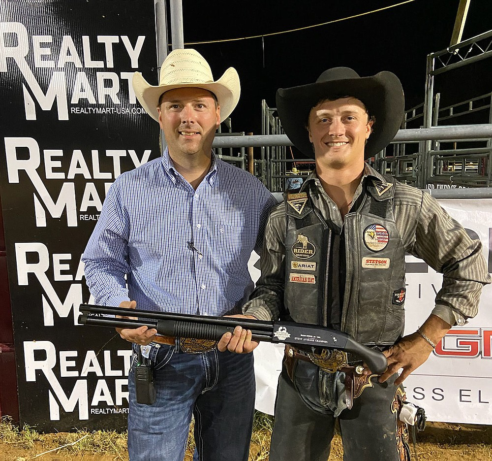 Photo Submitted Dakota Eagleburger (right), poses with Jeff Lee and his prize: an O.F. Mossberger and Sons rifle donated by Realty Mart USA. Eagleburger won the rifle during Event Average Championship