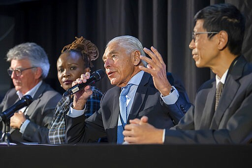 Patrick Aebischer, GESDA Vice Chairman, Nanjira Sambuli, Policy Analyst and Advocacy Strategist, Kenya, Peter Brabeck-Letmathe, GESDA Chairman, Chorh Chuan Tan, Chief Health Scientist, Singapore, left and right, speaks about the first Geneva Science and Diplomacy Anticipation Summit 2021 (GESDA), during a press conference at the Campus Biotech in Geneva, Switzerland, Thursday, October 07, 2021. (Martial Trezzini/Keystone via AP)