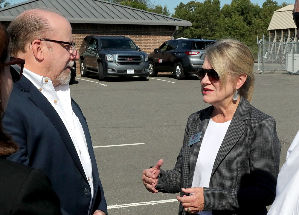 County Judge Darryl Mahoney, left, speaks with Arkansas Department of Transportation Director Lorie Tudor at Tuesday's ceremony. - Photo by Richard Rasmussen of The Sentinel-Record