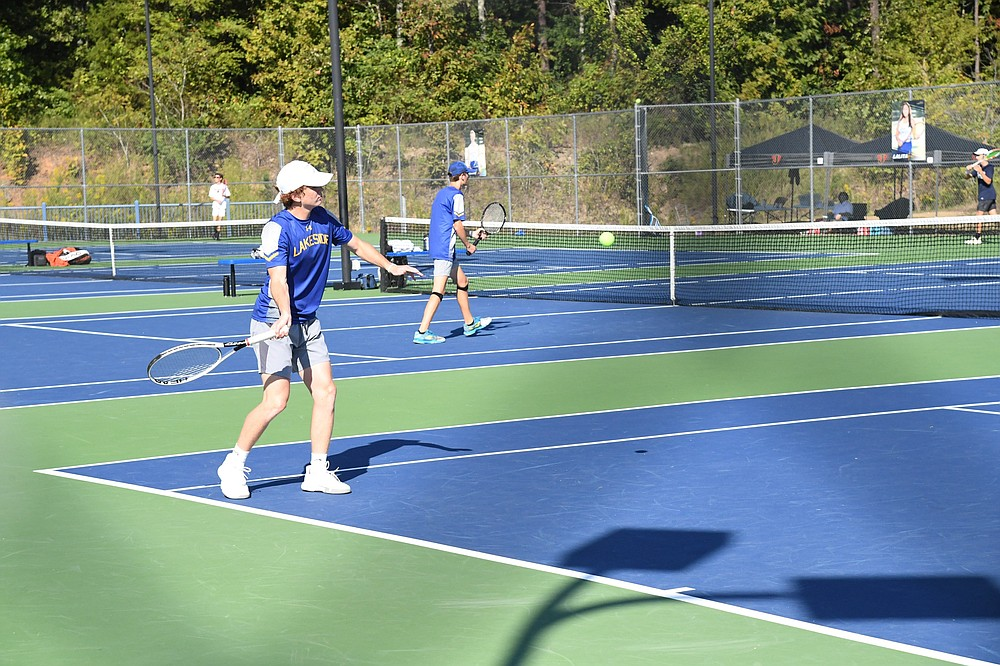 Lakeside's Griffin Gulley hits the ball against Jonesboro's Win Gibson and Mills Arnold in the Class 5A state semifinal Tuesday morning. Gulley and teammate William Ivy won the match and finished as the state runners-up. - Photo by Tanner Newton of The Sentinel-Record