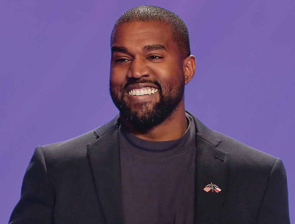 FILE - This Nov. 17, 2019, file photo shows Kanye West on stage during a service at Lakewood Church in Houston. The government's small business lending program has benefited millions of companies, with the goal of minimizing the number of layoffs Americans have suffered in the face of the coronavirus pandemic. Yet the recipients include many you probably wouldn't have expected. West's clothing-and-sneaker brand Yeezy received a loan of between $2 million and $5 million, according to the data released by Treasury. The company employed 106 people in mid-February before the pandemic struck. (AP Photo/Michael Wyke, File)