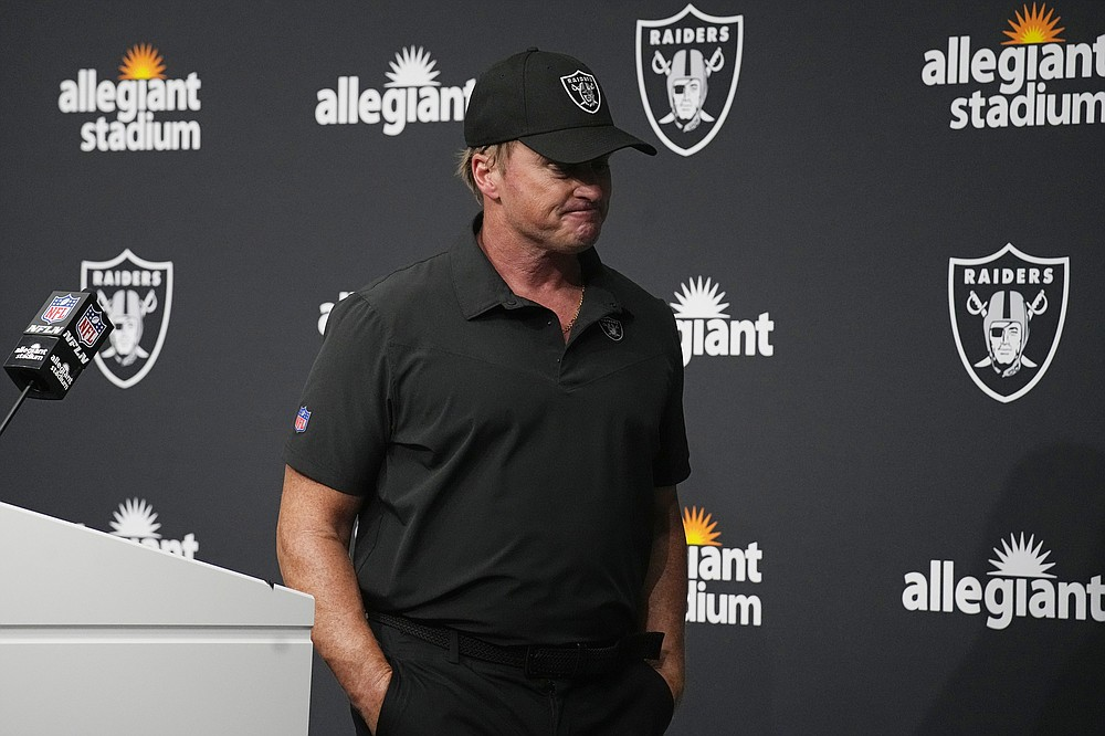 FILE - Las Vegas Raiders head coach Jon Gruden leaves after speaking during a news conference after an NFL football game against the Chicago Bears in Las Vegas, in this Sunday, Oct. 10, 2021, file photo. Jon Gruden is out as coach of the Las Vegas Raiders after emails he sent before being hired in 2018 contained racist, homophobic and misogynistic comments. Gruden released a statement Monday night, Oct. 11, 2021, that he is stepping down after The New York Times reported that Gruden frequently used misogynistic and homophobic language directed at Commissioner Roger Goodell and others in the NFL. (AP Photo/Rick Scuteri, File)