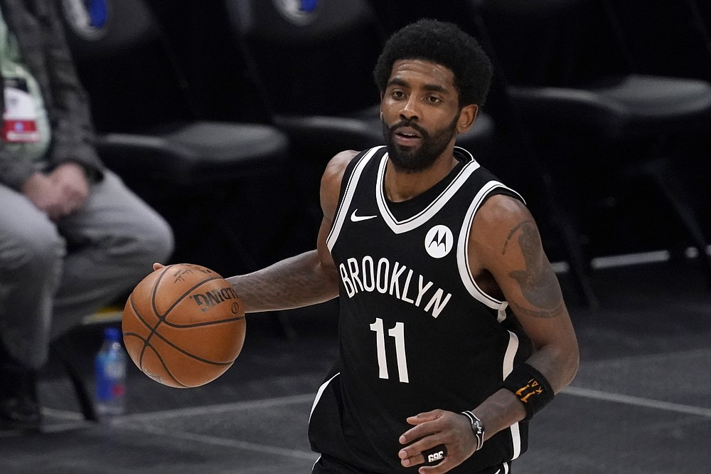 FILE - Brooklyn Nets guard Kyrie Irving handles the ball during an NBA basketball game against the Dallas Mavericks in Dallas, in this Thursday, May 6, 2021, file photo. Unable to attend the Brooklyn Nets' media day, Kyrie Irving asked for privacy Monday when pressed about his vaccination status and availability for home games. (AP Photo/Tony Gutierrez)