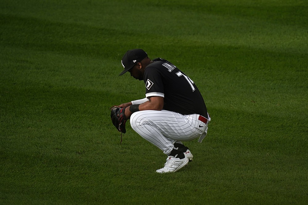 Chicago White Sox left fielder Eloy Jimenez waits during a mound visit against the Chicago White Sox in the eighth inning during Game 4 of a baseball American League Division Series Tuesday, Oct. 12, 2021, in Chicago. (AP Photo/Charles Rex Arbogast)