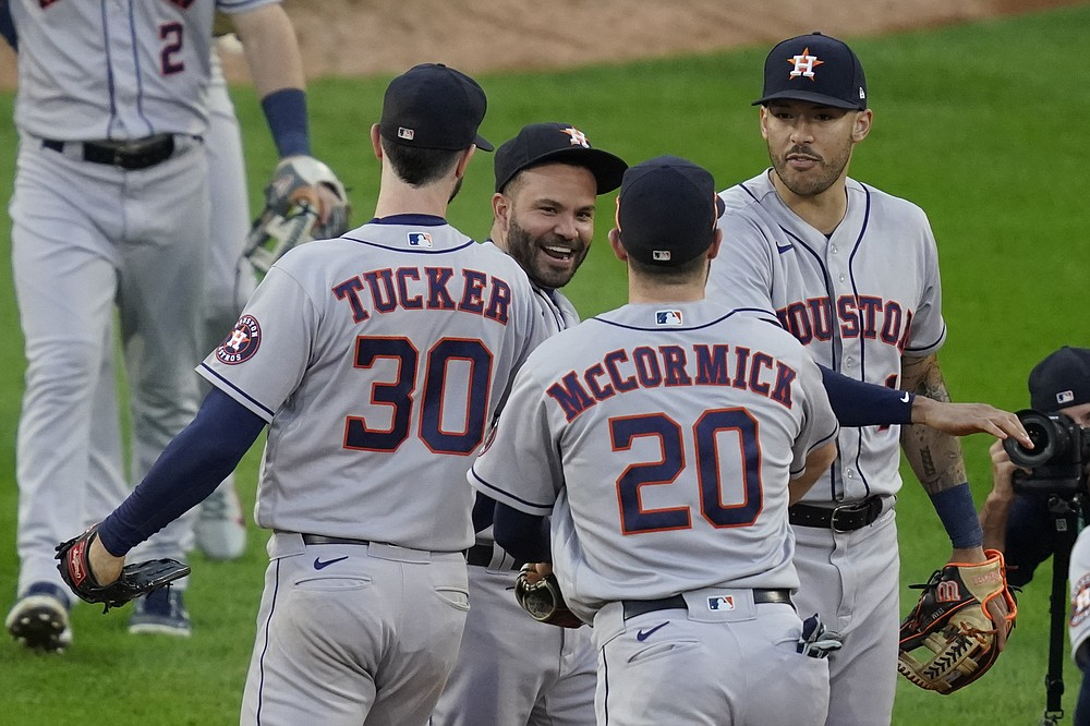 Houston Astros' Jose Altuve (27) celebrates with Kyle Tucker (30), Chas McCormick (20) andCarlos Correa (1) after beating the Chicago White Sox 10-1 in Game 4 of a baseball American League Division Series Tuesday, Oct. 12, 2021, in Chicago. (AP Photo/Charles Rex Arbogast)