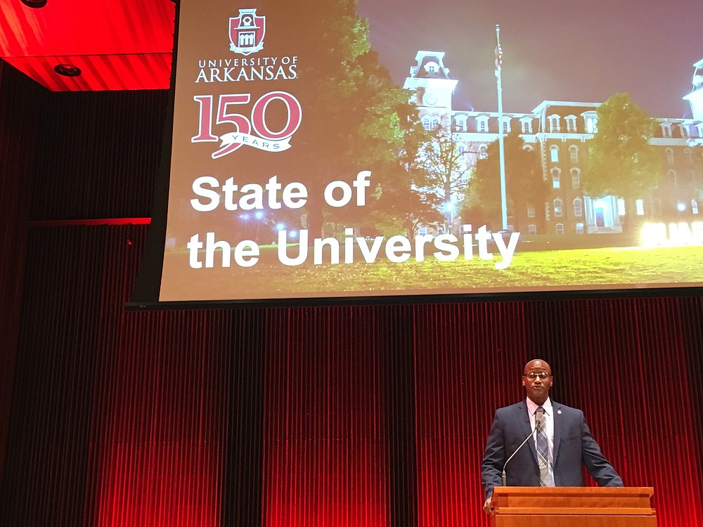Charles Robinson, interim chancellor for the University of Arkansas, Fayetteville, gives his state-of-the-university address Tuesday at Faulkner Performing Arts Center on the UA campus. (Democrat-Gazette/Jaime Adame)