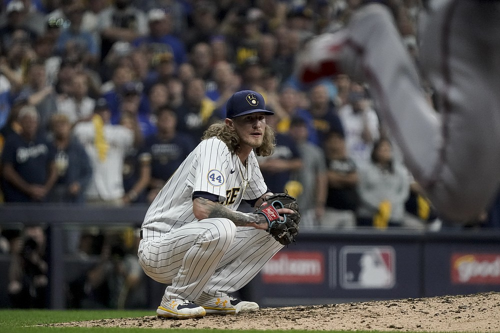 Milwaukee Brewers relief pitcher Josh Hader watches the last during their win against the Atlanta Braves in Game 1 of baseball's National League Divisional Series Friday, Oct. 8, 2021, in Milwaukee. (AP Photo/Morry Gash)