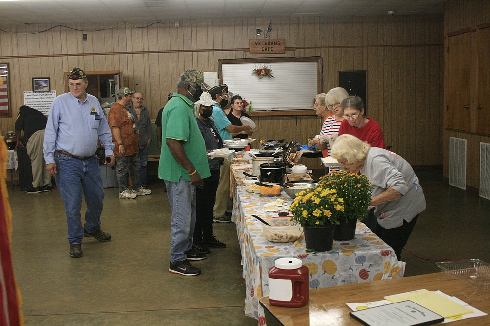 The American Legion Post 10 hosted a chili cookoff Tuesday night; they also awarded two local girls for their entries into a statewide anti-drug poster contest and accepted a donation of an automated external defibrillator from ProMed Ambulance. (Matt Hutcheson/News-Times)