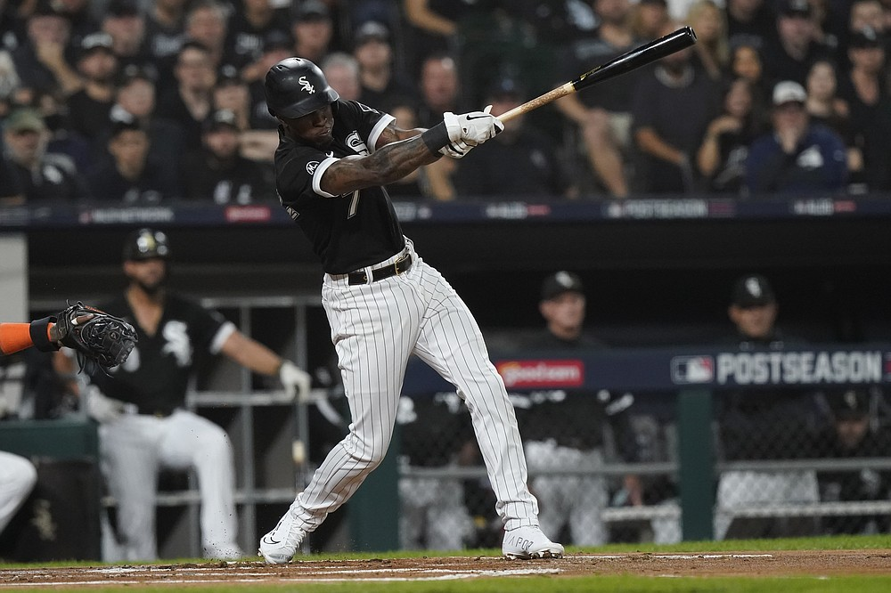 Chicago White Sox's Tim Anderson hits a single against the Houston Astros in the first inning during Game 3 of a baseball American League Division Series Sunday, Oct. 10, 2021, in Chicago. (AP Photo/Nam Y. Huh)