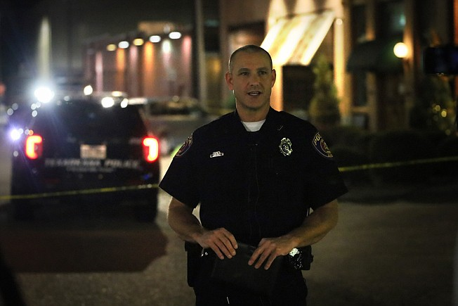 Texarkana Arkansas Police Department spokesman Cpl. Kelly Pilgreen near Zapata's Wednesday night, where an officer-involved shooting took place. Arkansas State Police will investigate the shooting involving an off-duty TAPD officer. (Staff photo by Danielle Dupree)