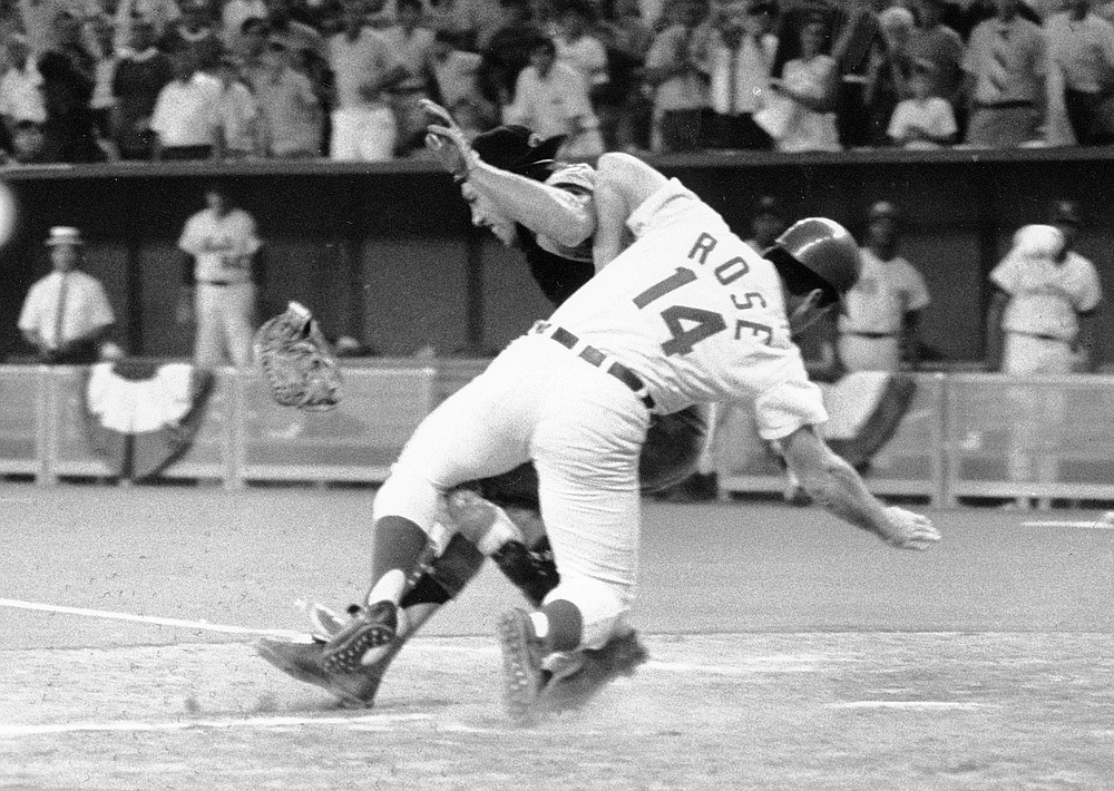 FILE - In this July 14, 1970, file photo, National League's Pete Rose collides with American League catcher Ray Fosse as he scores the winning run during the 12th inning of the baseball All-Star Game in Cincinnati. Fosse, the strong-armed catcher whose career was upended when he was bowled over by Rose, has died. He was 74. Carol Fosse, his wife of 51 years, said in a statement Fosse died Wednesday, Oct. 13, 2021, after a 16-year bout with cancer. (AP Photo/File)