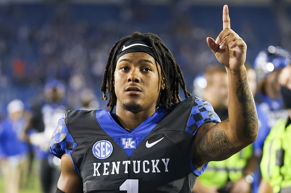 Kentucky wide receiver Wan'Dale Robinson acknowledges fans while walking off the field after the team's NCAA college football game against LSU in Lexington, Ky., Saturday, Oct. 9, 2021. (AP Photo/Michael Clubb)