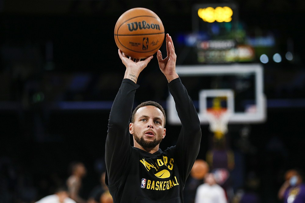Golden State Warriors guard Stephen Curry warms up before a preseason NBA basketball game against the Los Angeles Lakers in Los Angeles, Tuesday, Oct. 12, 2021. (AP Photo/Ringo H.W. Chiu)